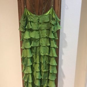 Green silk flapper dress with long necklace